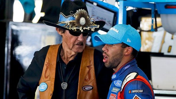 FILE - In this June 9, 2017, file photo, Richard Petty, left, and Darrell Wallace Jr. chat during practice for Sunday's NASCAR Cup series auto race in Long Pond, Pa. Wallace will drive Petty's iconic No. 43 full-time in the NASCAR Cup Series next year, the team announced Wednesday, Oct. 25, 2017. (AP Photo/Matt Slocum, File)