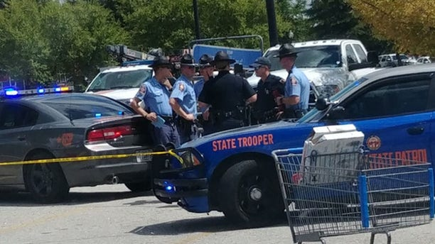 Police converged on a Walmart in Covington, Georgia, after police exchanged gunfire with a shoplifting suspect. An officer was wounded the suspect was killed.