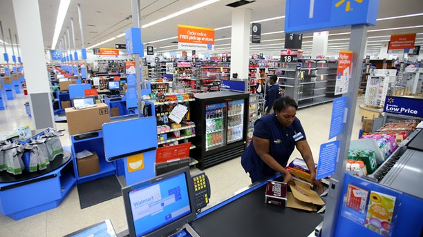 File photo - A worker prepares the check-out area at a Walmart Super Center prior to its opening in Compton, California, U.S., Jan. 10, 2017. (REUTERS/Mike Blake)