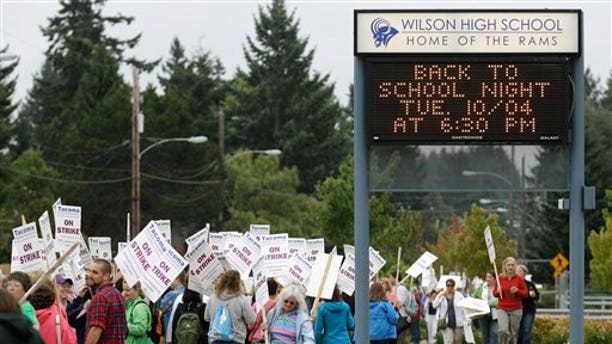 Sept. 13: Striking teachers picket outside Wilson High School next to a sign announcing an upcoming back-to-school night, in Tacoma, Wash. School was closed for 28,000 students Tuesday after teachers in Washington state's third-largest school district voted to strike Monday night.