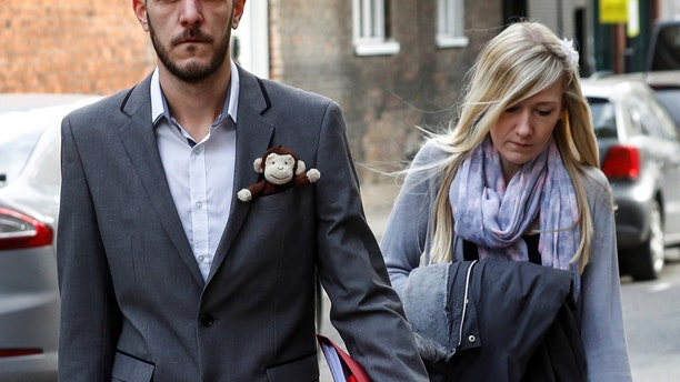 Chris Gard and Connie Yates, who are battling to take their baby Charlie to the US for treatment against advice from doctors that he should be taken off life support arrive at The High Court in London, Britain April 5, 2017.    REUTERS/Eddie Keogh - RTX347VA