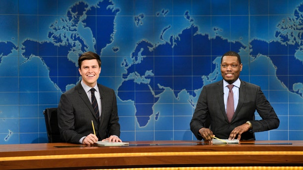 """In this March 4, 2017 photo provided by NBC, Colin Jost and Michael Che, right, appear during Weekend Update segment of """"Saturday Night Live"""" in New York. """"Saturday Night Live"""" gets the summer off but """"Weekend Update"""" will keep the political satire coming in prime-time. NBC said Tuesday, March 14, 2017, that four episodes of """"Saturday Night Live: Weekend Update"""" will air at 9 p.m. Thursday starting Aug. 10."""