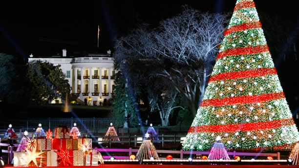 Dec. 4, 2014: The National Christmas Tree is lighted on the Ellipse in front of the White House in Washington.