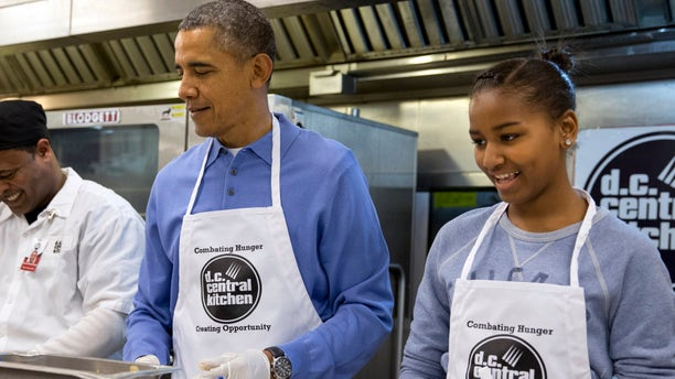 Monday, Jan. 20, 2014: President Obama and his daughter Sasha, right, make burritos at DC Central Kitchen as part of a service project in honor of Martin Luther King, Jr. Day.
