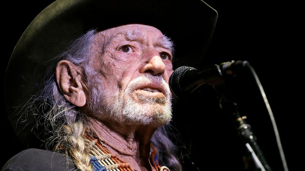Willie Nelson, here in a January 2017 photo, keeps up a rigorous touring and recording schedule. He is 84 years old.