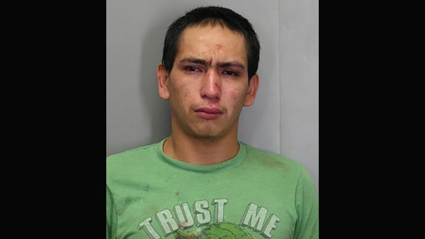 """Wilmer Garcia, is accused of stealing a car while wearing a """"Trust Me"""" t-shirt."""