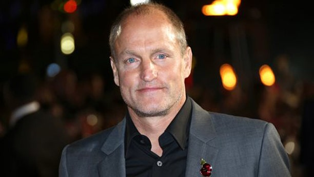 """This Nov. 5, 2015 photo shows Woody Harrelson at premiere of the """"The Hunger Games Mockingjay Part 2"""" film in London.  (Photo by Joel Ryan/Invision/AP)"""