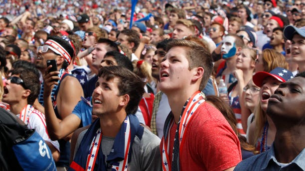 July 1, 2014: Fans watch as Belgium scores against the U.S. during the Brazil 2014 World Cup viewing party at Solider Field.