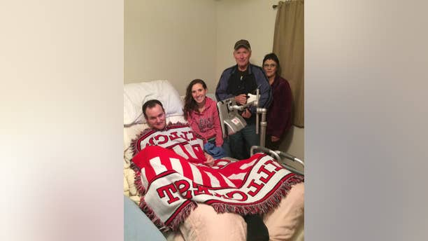 Wyatt Rees and his wife, Mindy, are pictured with the Clarks, who gave them an adaptive van after hearing about their story.