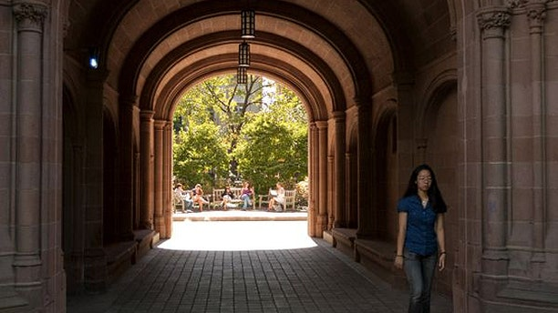 A student at Yale University walks on campus in 2009. Yale officials told FoxNews.com the university is currently considering to cover gender reassignment surgery in its health insurance coverage for students. (AP)