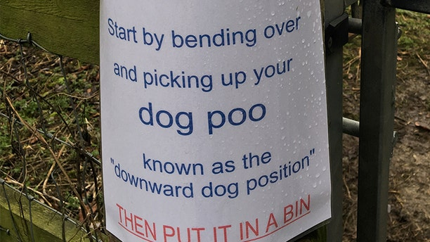 A humorous sign suggesting people do yoga by bending over to pick up their dog poo has gone viral.