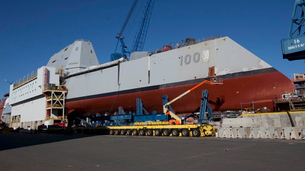 In this photo made Tuesday, Oct. 8, 2013, the first-in-class Zumwalt, the largest U.S. Navy destroyer ever built, is seen at Bath Iron Works in Bath, Maine. The christening of the Zumwalt was canceled once because of the government shutdown. But plans call for the ship to be moved to dry dock in Maine and floated without fanfare in the coming days.