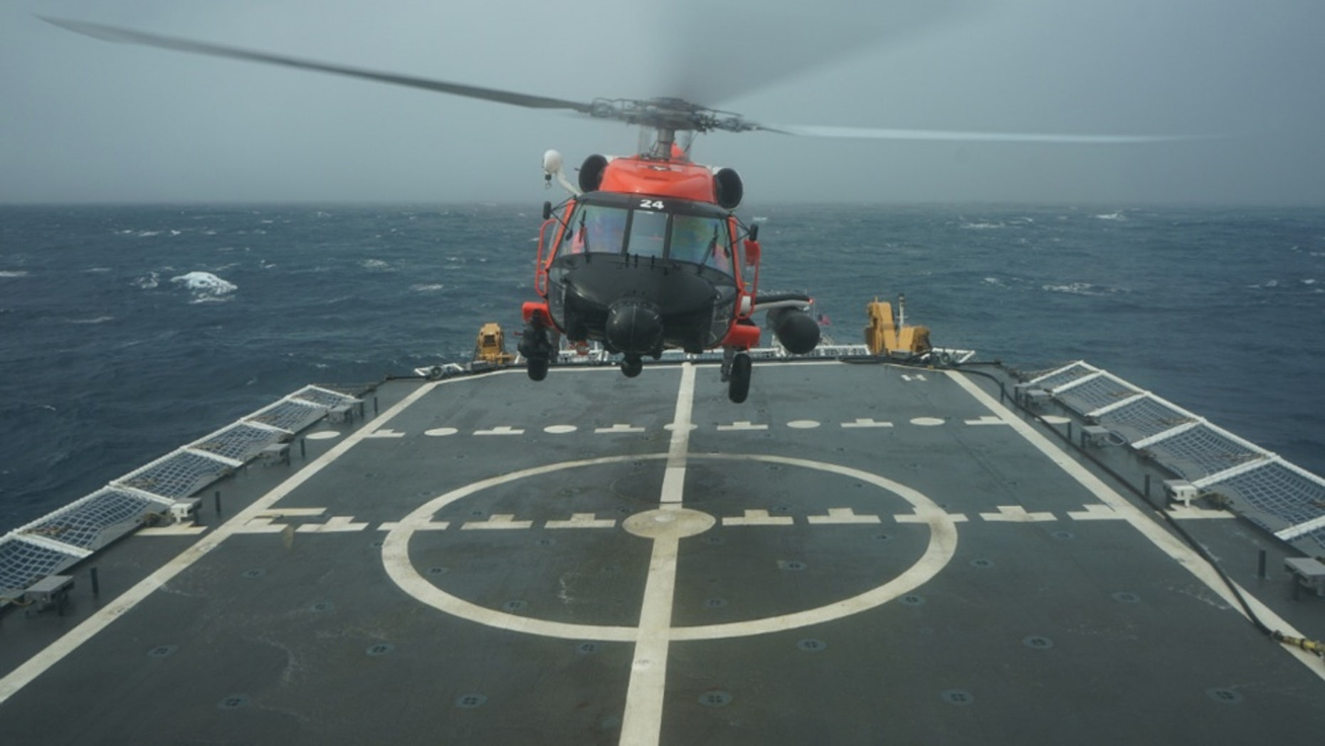 A Coast Guard rescue helicopter takes off from the deck of the Cutter Hamilton to continue searching for a missing civilian aircraft Oct. 27, 2018, 110 miles east of Charleston, South Carolina.