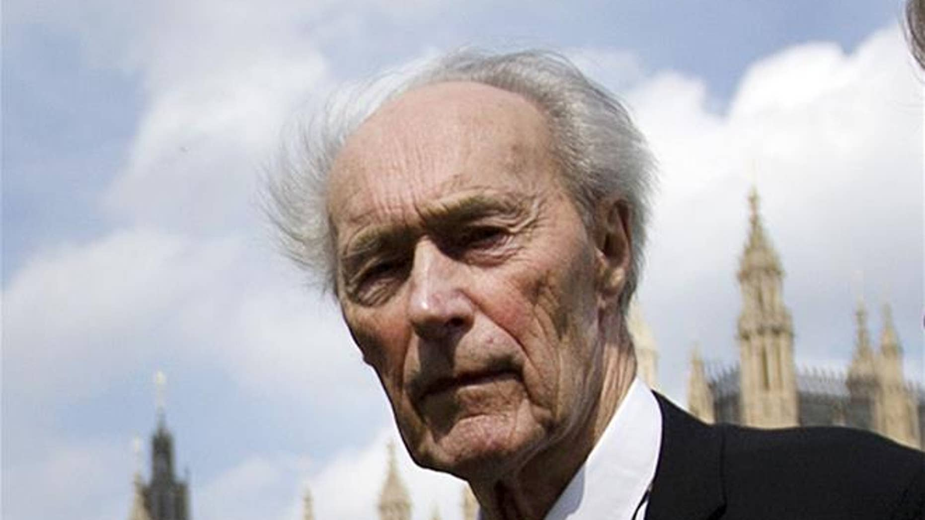 In this April 25, 2013, file photo, Norwegian war hero and resistance fighter Joachim Roenneberg walks in a park near the Palace of Westminster in London.
