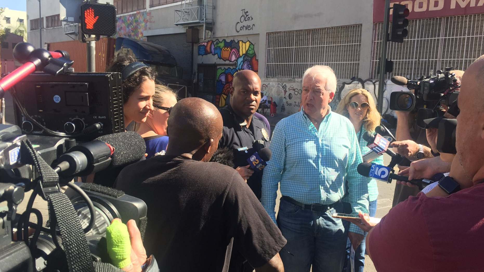 Republican gubernatorial candidate, fourth from right, talking to reporters while touring Los Angeles' skid row on Tuesday.