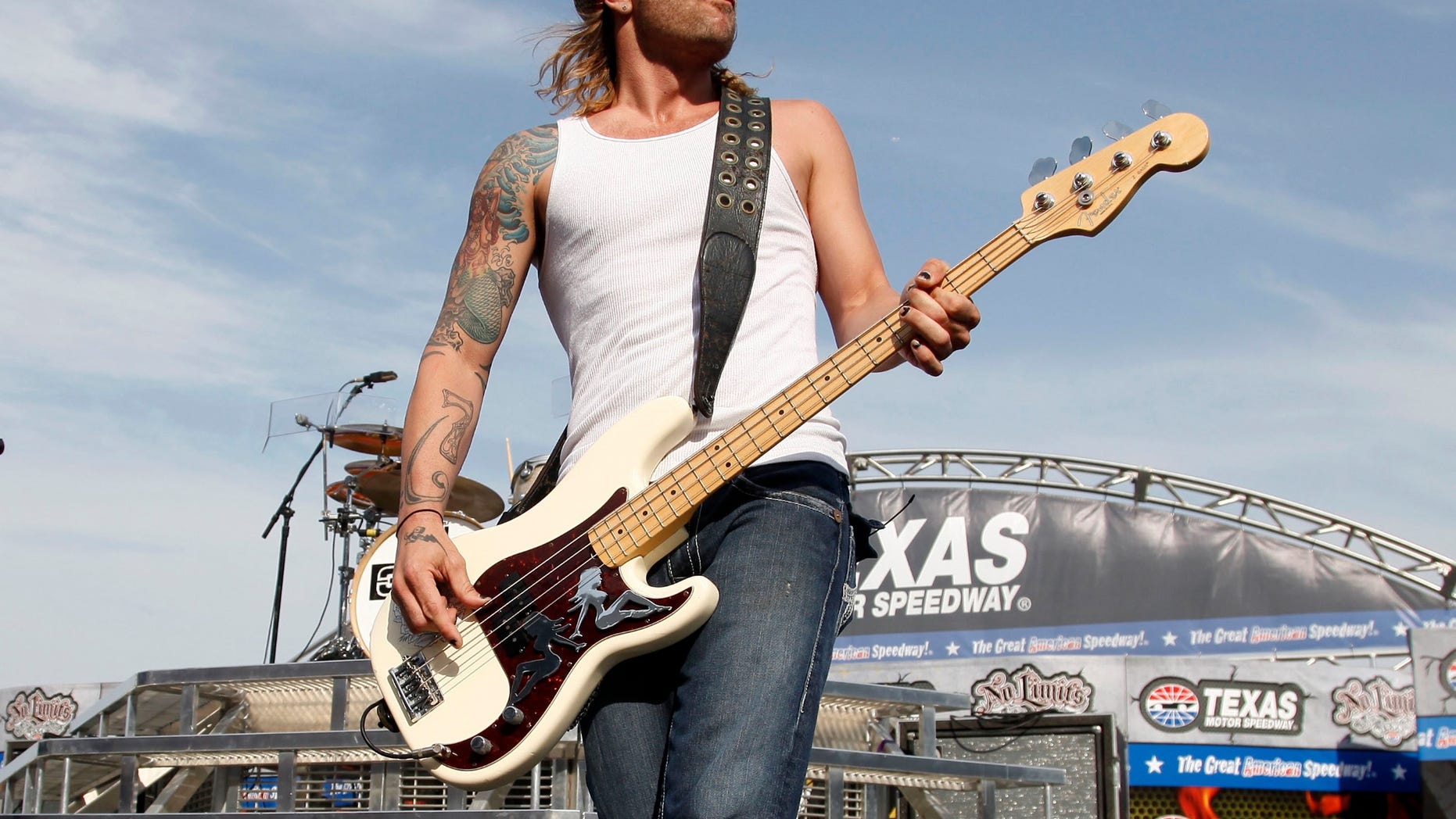 FILE - In this April 9, 2011 file photo, 3 Doors Down' bassist Todd Harrell performs before a NASCAR auto race at Texas Motor Speedway in Fort Worth, Texas. Harrell, the founding member and former bassist of the rock band 3 Doors Down has been sentenced to 10 years in Mississippi state prison for possession of a firearm by a felon. News outlets report Jackson County Circuit Court Judge Robert Krebs gave Todd Harrell the maximum penalty during a hearing Thursday, Oct. 11, 2018.