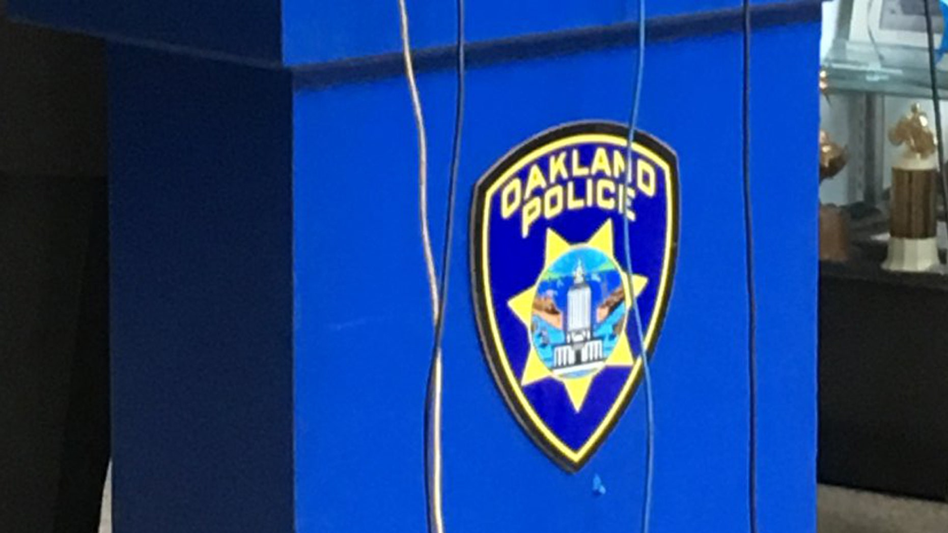 A body was found across the street from the Oakland Police Department on Tuesday.