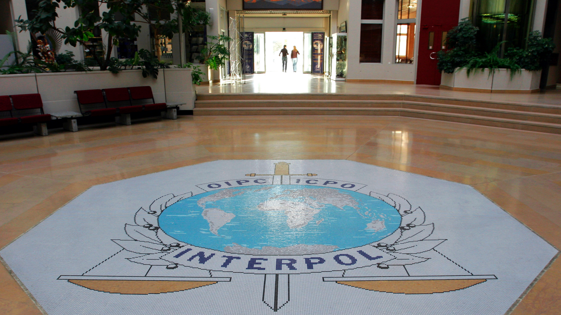 FILE - This Oct.16, 2007 file photo shows the entrance hall of Interpol's headquarters in Lyon, central France. (AP Photo/Laurent Cipriani, File)
