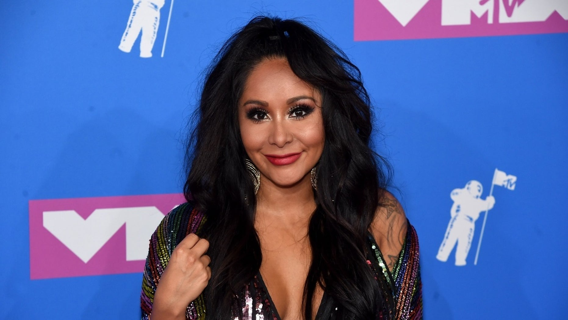 """Nicole """"Snooki"""" Polizzi responded to social media users criticizing her daughter's appearance at a wedding show on Saturday, Sept. 29, 2018."""
