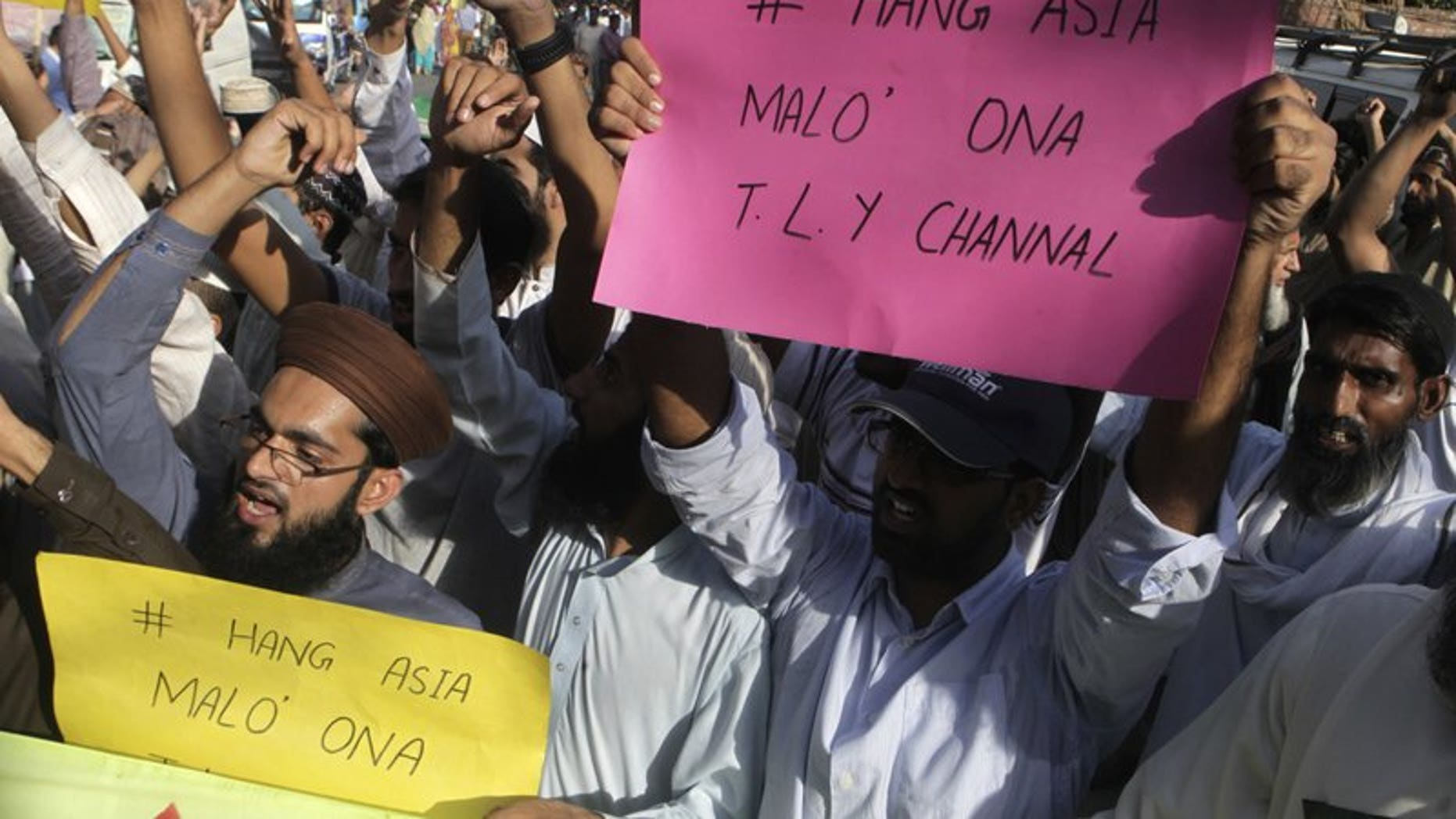 FILE 2016: Supporters of a Pakistani religious group shout slogans demanding the hanging of a Christian woman, Aasia Bibi.