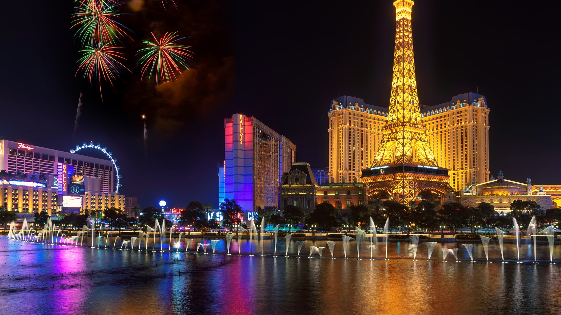 Las Vegas, Nevada - July 4, 2016: Fireworks at Bellagio Fountains in front of Paris Las Vegas hotel and casino and a replica of the Eiffel Tower in Las Vegas