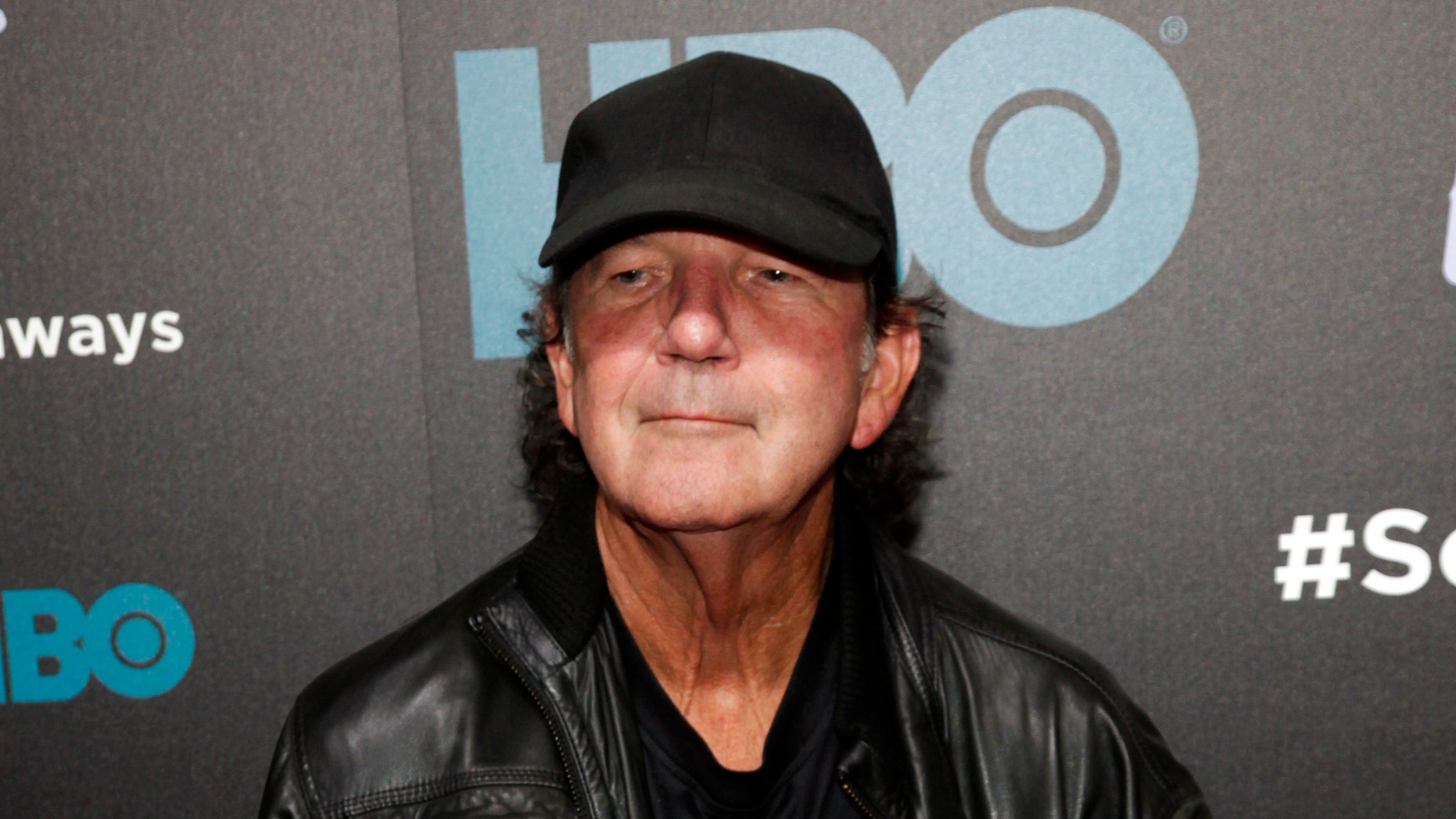 """FILE - In this Oct. 14, 2014 file photo, Tony Joe White attends the premiere of HBO's """"Foo Fighters Sonic Highway"""" in New York. White, who had a hit in 1969 with """"Polk Salad Annie"""" and whose songs were covered by music greats like Elvis Presley, Hank Williams Jr., Tina Turner, Ray Charles and Waylon Jennings, died Wednesday, Oct. 24, 2018. He was 75."""