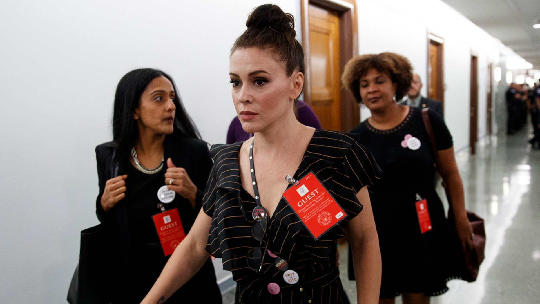 Actress Alyssa Milano walks to a Senate Judiciary Committee meeting after a break on Capitol Hill in Washington, Thursday, Sept. 27, 2018, during a hearing for Supreme Court nominee Brett Kavanaugh.
