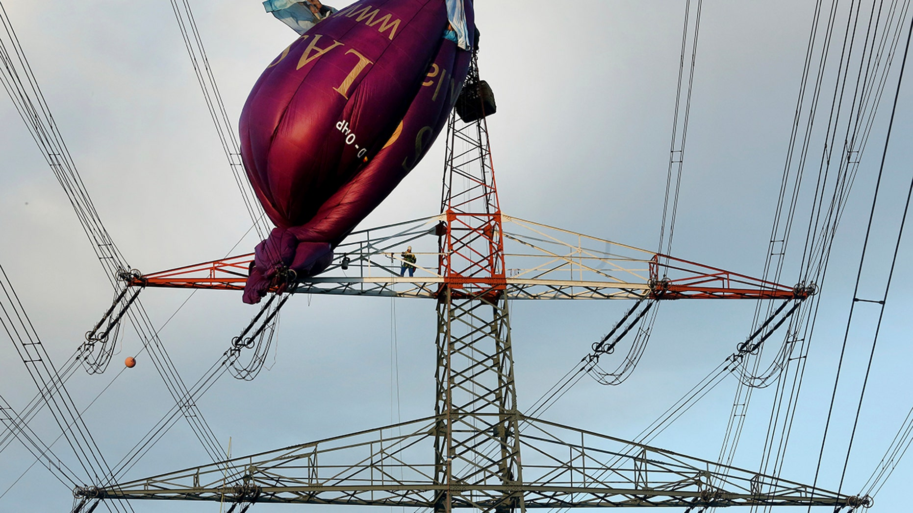 Hot air balloon hits German power line tower, prompting dramatic ...