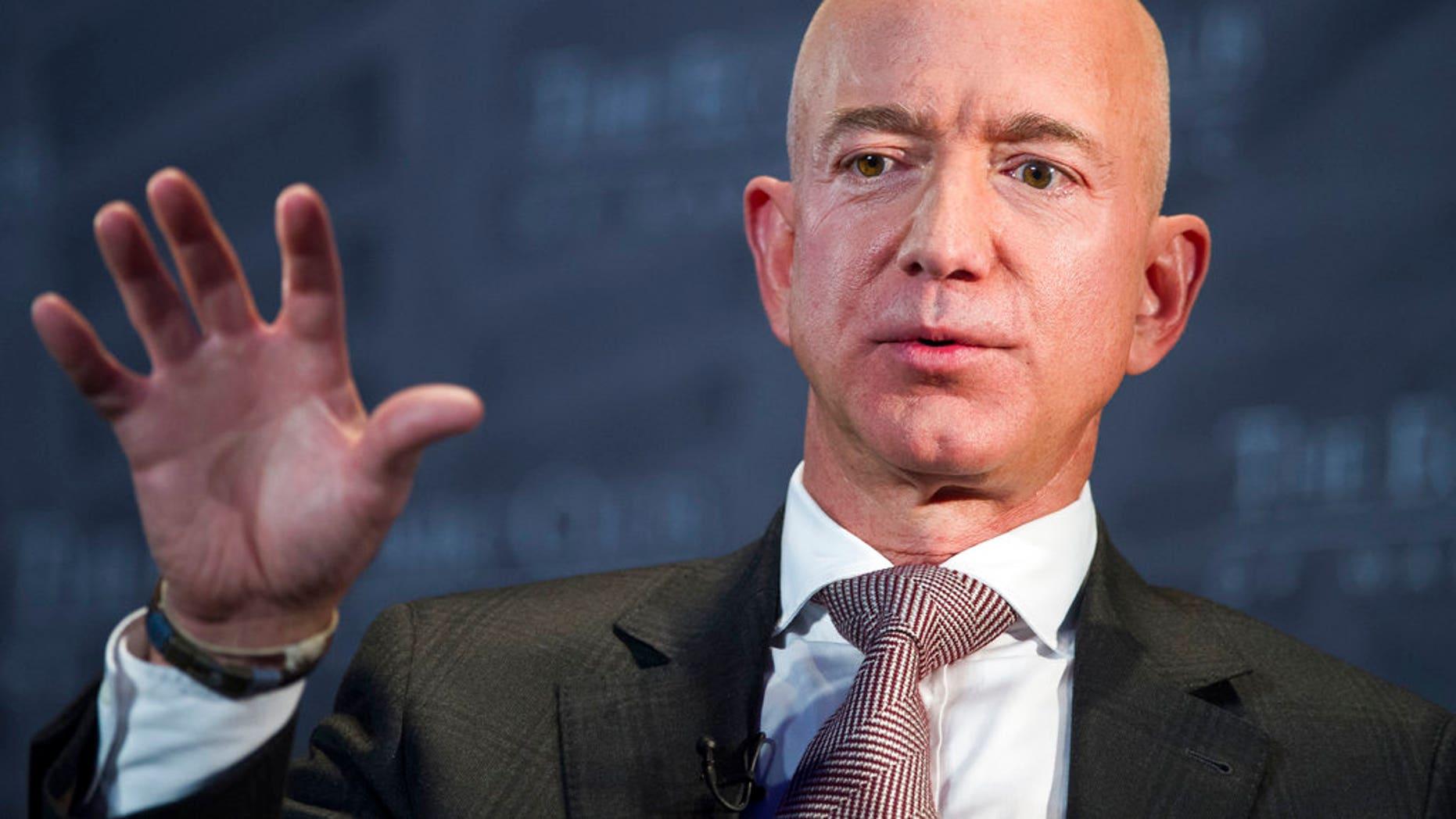 File photo: Jeff Bezos, Amazon founder and CEO, speaks at The Economic Club of Washington's Milestone Celebration in Washington.