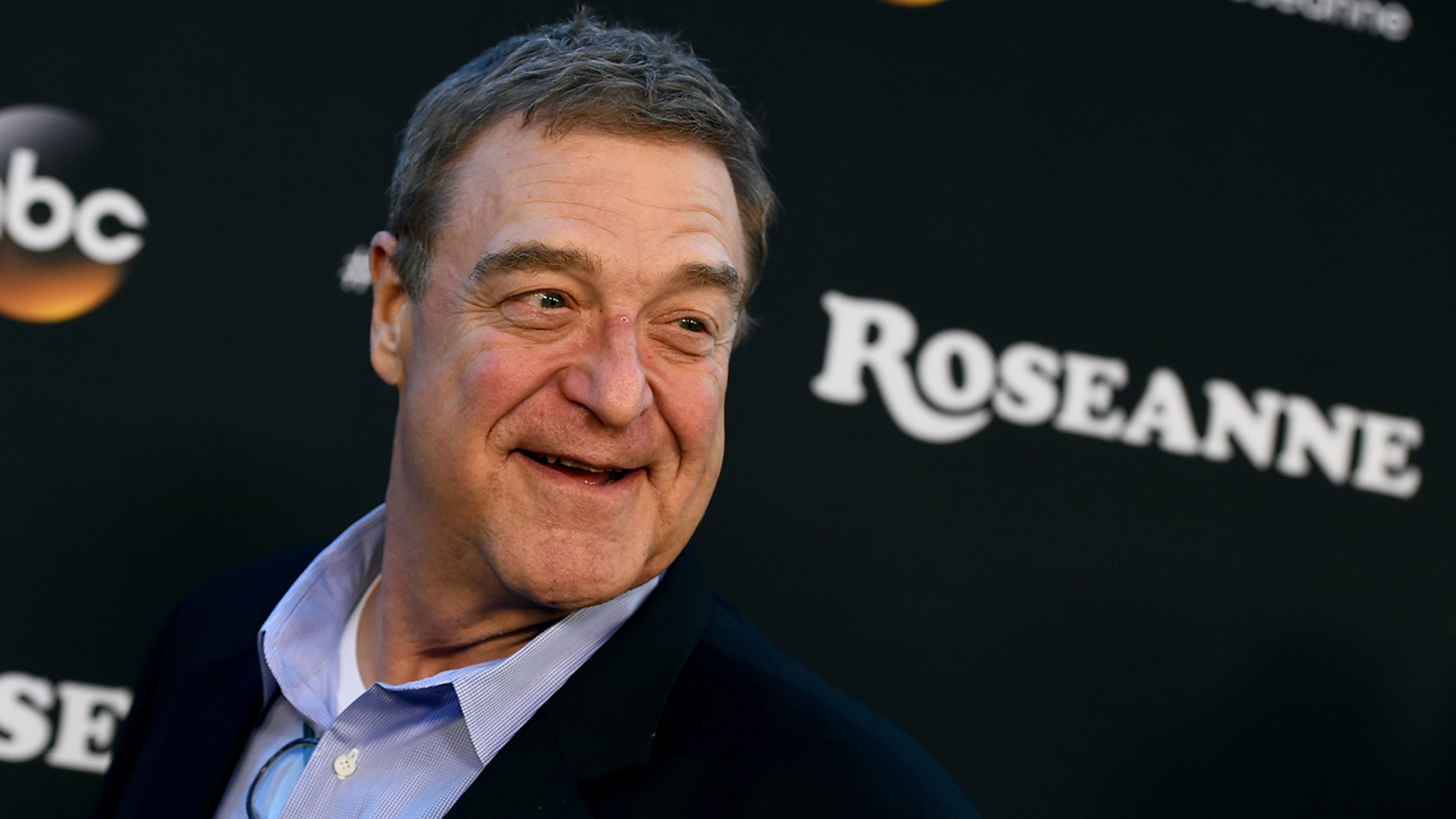 "John Goodman arrives at the Los Angeles premiere of ""Roseanne"" in Burbank, Calif., March 23, 2018."
