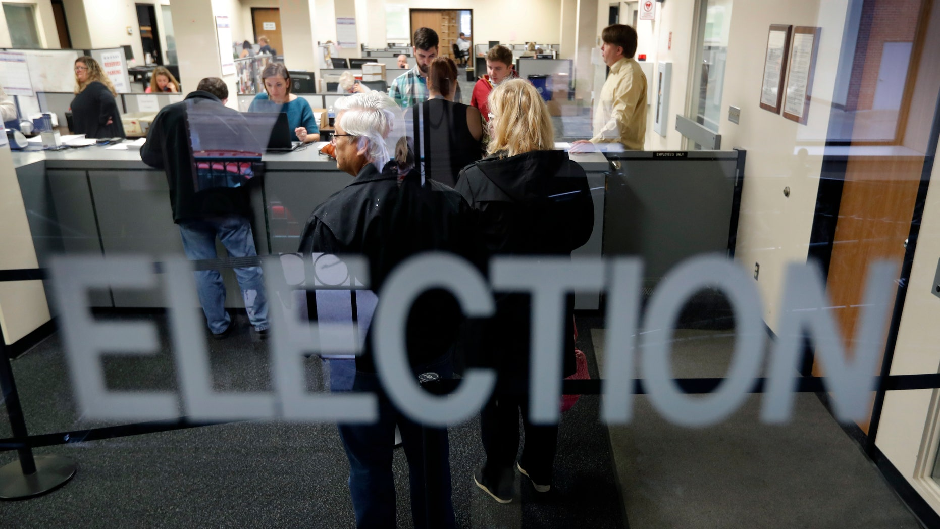 Some states allow residents to register to vote on Election Day. (AP Photo/Charlie Neibergall)