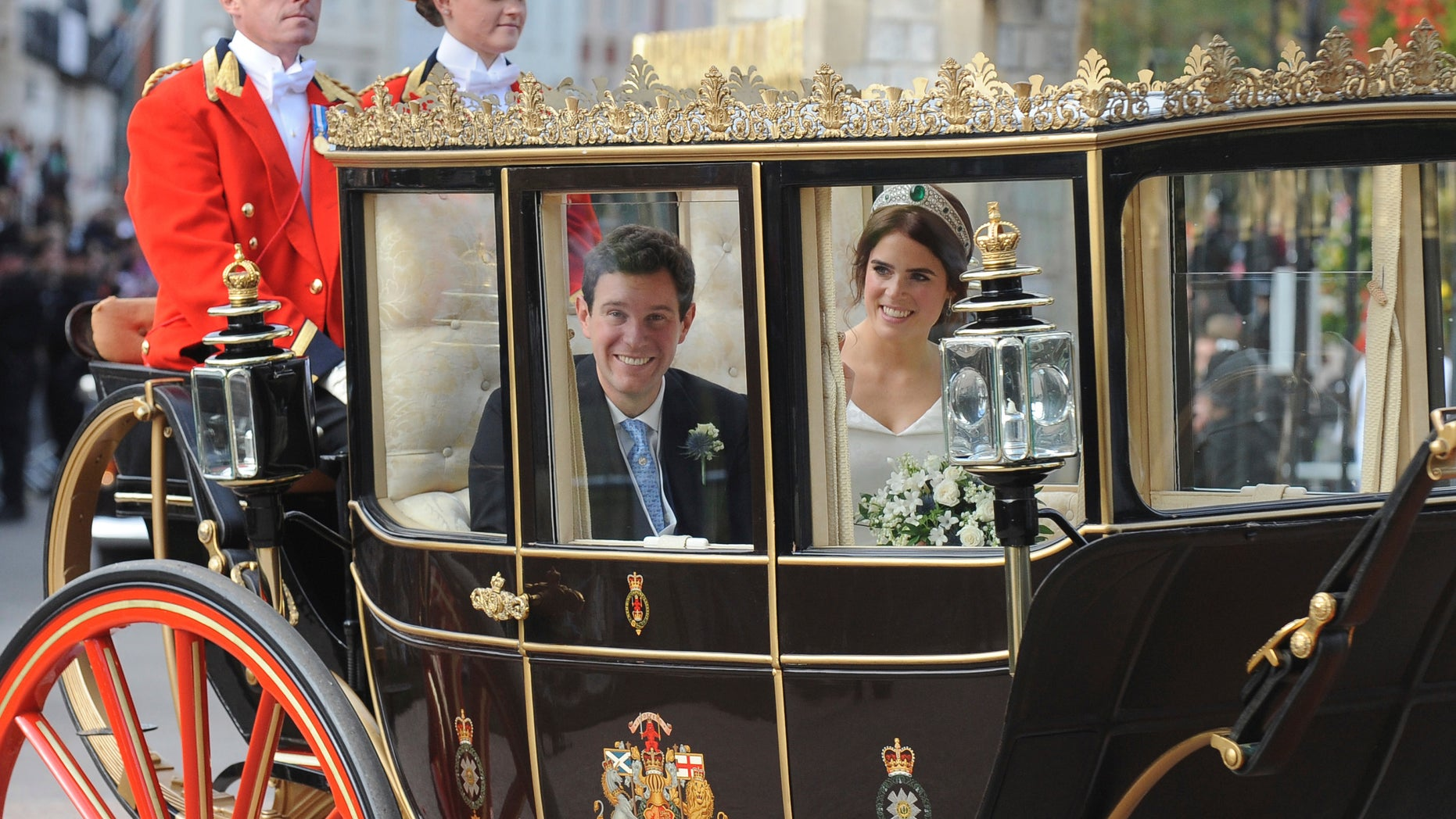 Princess Eugenie of York, right, and Jack Brooksbank travel from St. George's Chapel to Windsor Castle after their wedding.