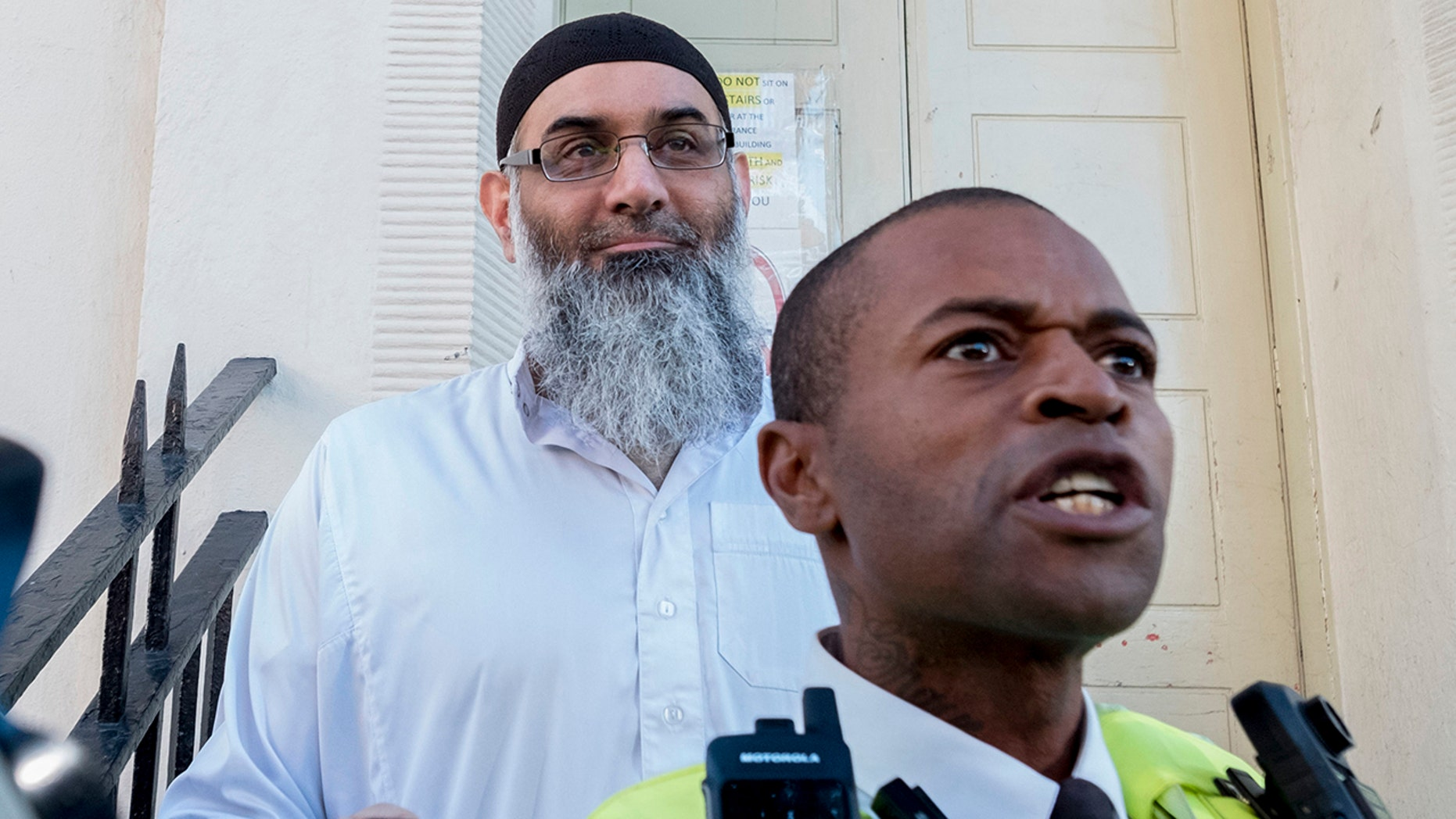 Anjem Choudary leaves a bail hostel in north London after his release from Belmarsh Prison, Friday Oct. 19, 2018. A radical Islamic preacher was released from a British prison Friday after serving less than half of a 5-1/2-year prison sentence for encouraging support for the Islamic State group. (David Mirzoeff/PA via AP)