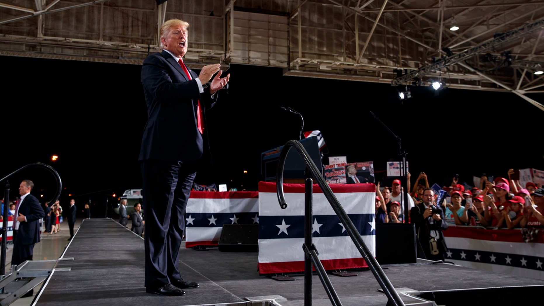 President Donald Trump calls out as he leaves the stage after speaking at a campaign rally at International Air Response, Friday, Oct. 19, 2018, in Mesa, Ariz.