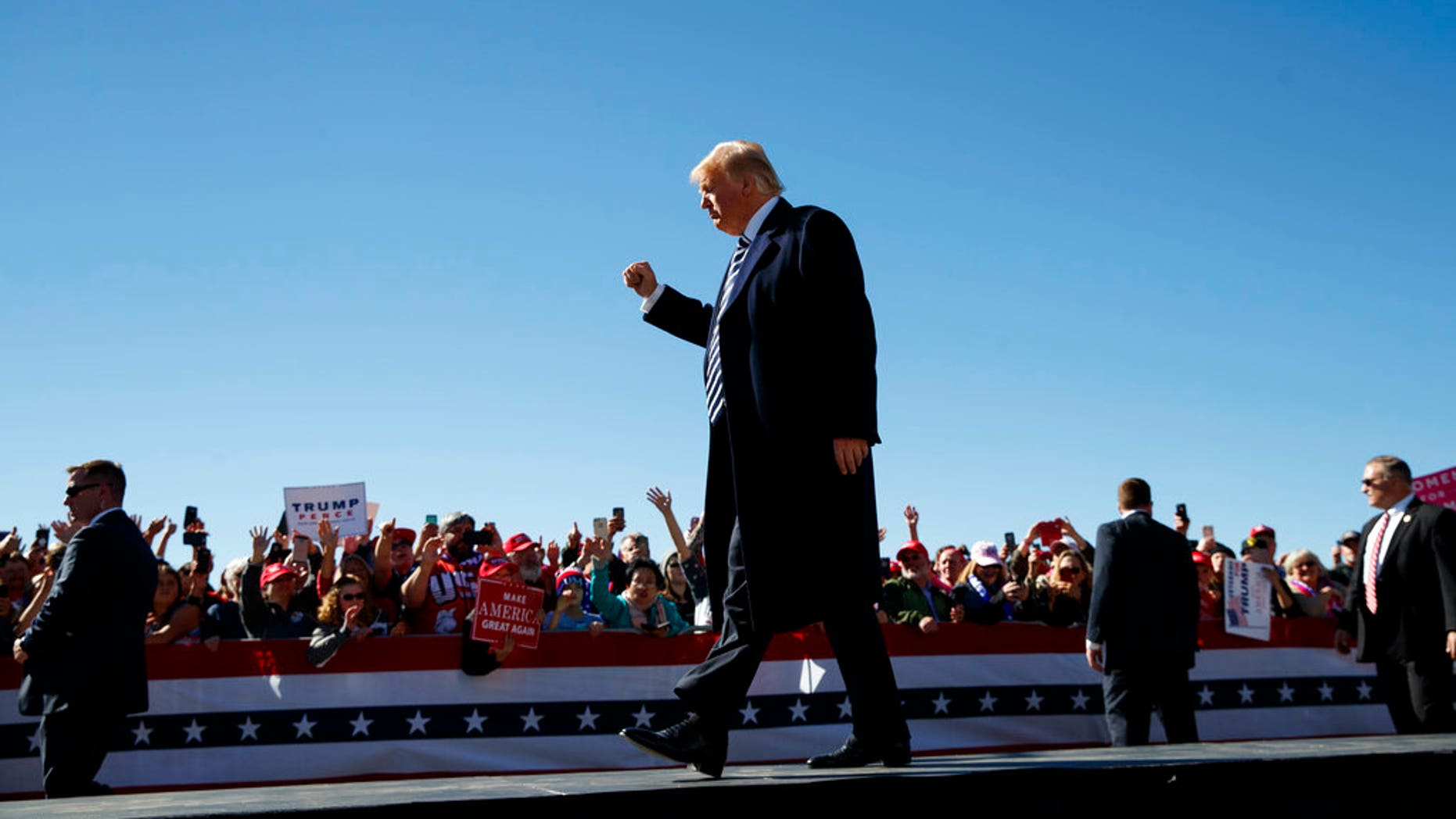 President Donald Trump walks from the stage at Elko Regional Airport, Saturday, He spoke about the INF treaty following his rally in Nevada.(AP Photo/Carolyn Kaster)