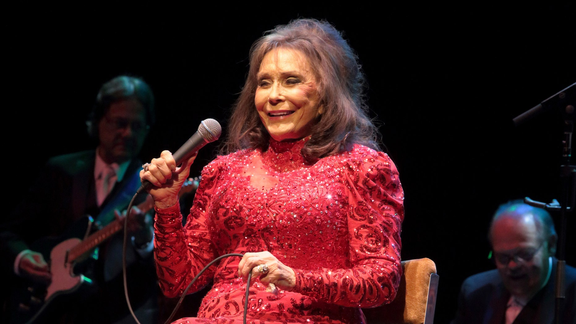 In this Aug. 28, 2016 file photo, Loretta Lynn performs in concert at the American Music Theater in Lancaster, Pa. Lynn says she is doing better after a brief hospital visit to treat an illness that kept her from attending a CMT tribute to her and other female country artists.
