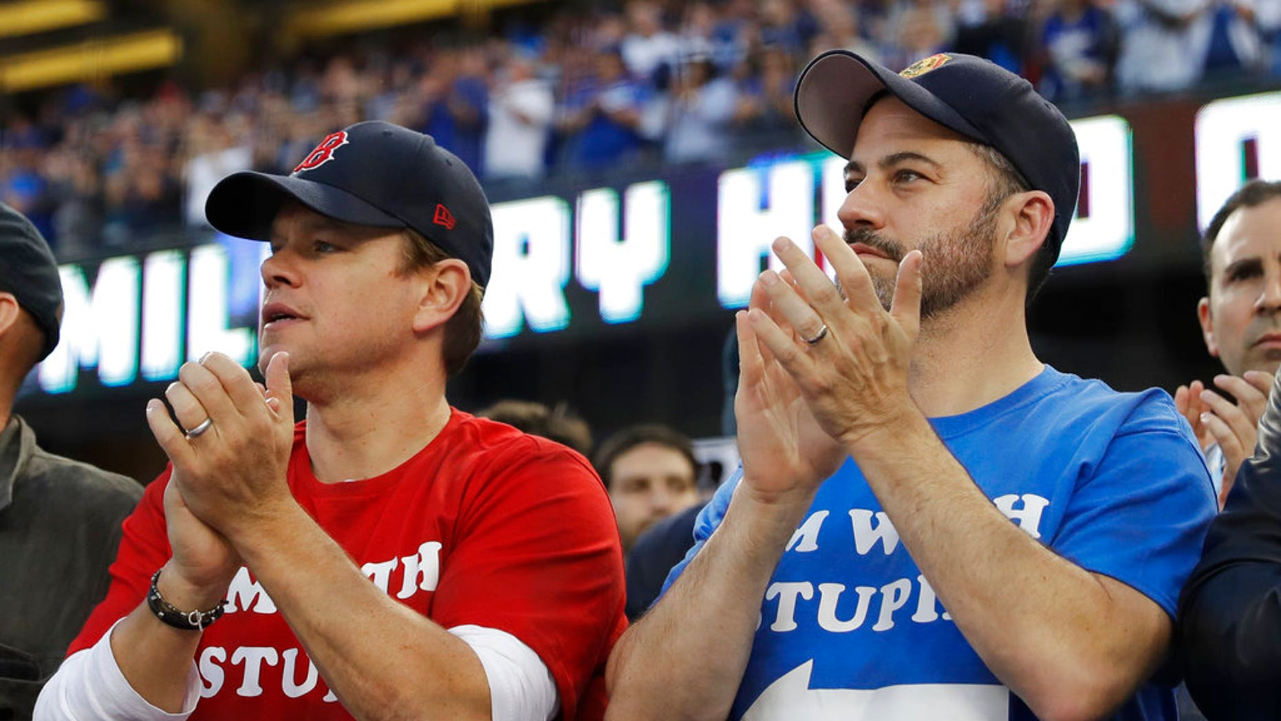 Matt Damon and Jimmy Kimmel watch Game 5 of the World Series baseball game between the Boston Red Sox and Los Angeles Dodgers on Sunday.