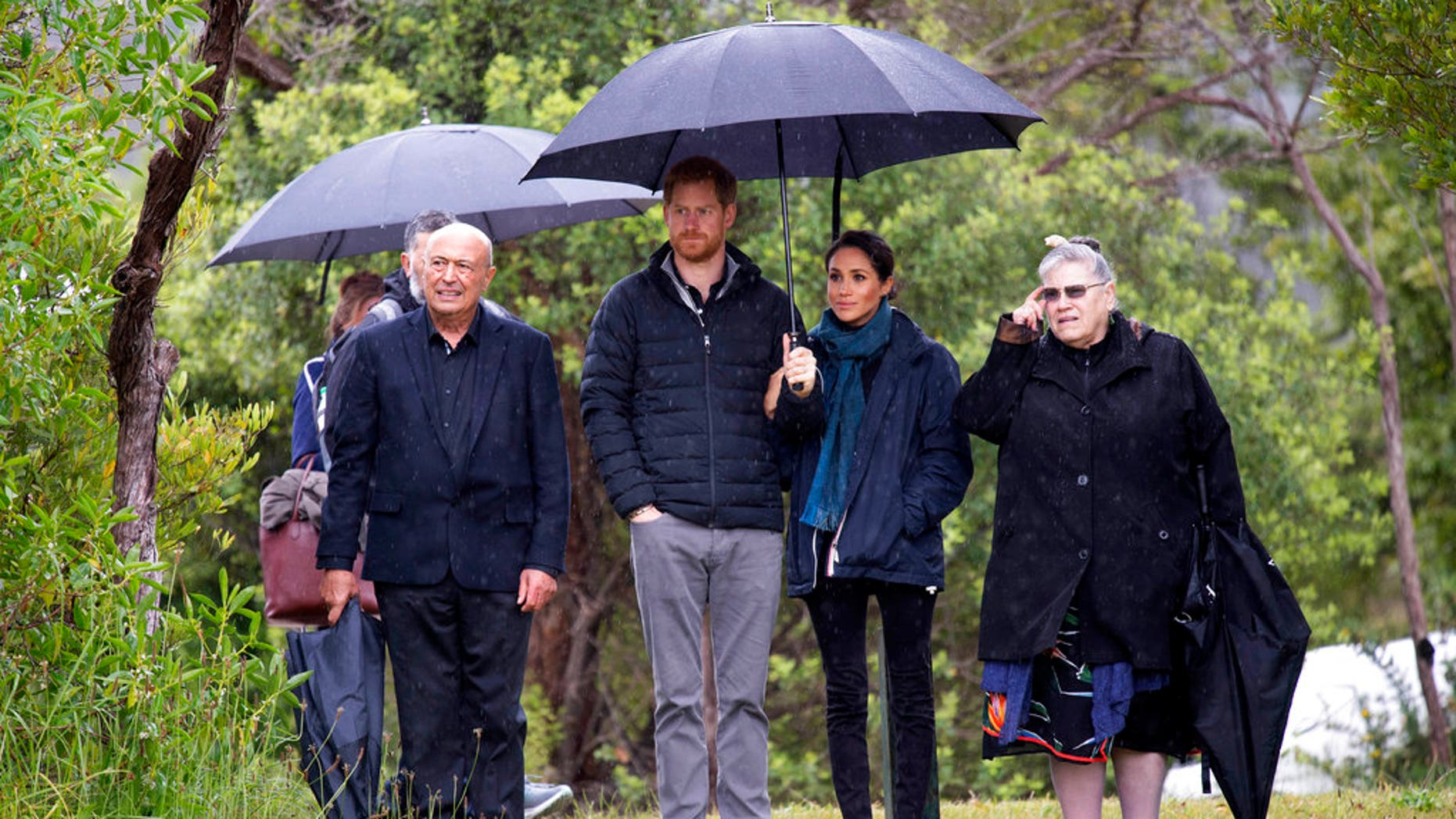 Prince Harry mentioned Duchess Meghan's growing baby bump while thanking fans in New Zealand.