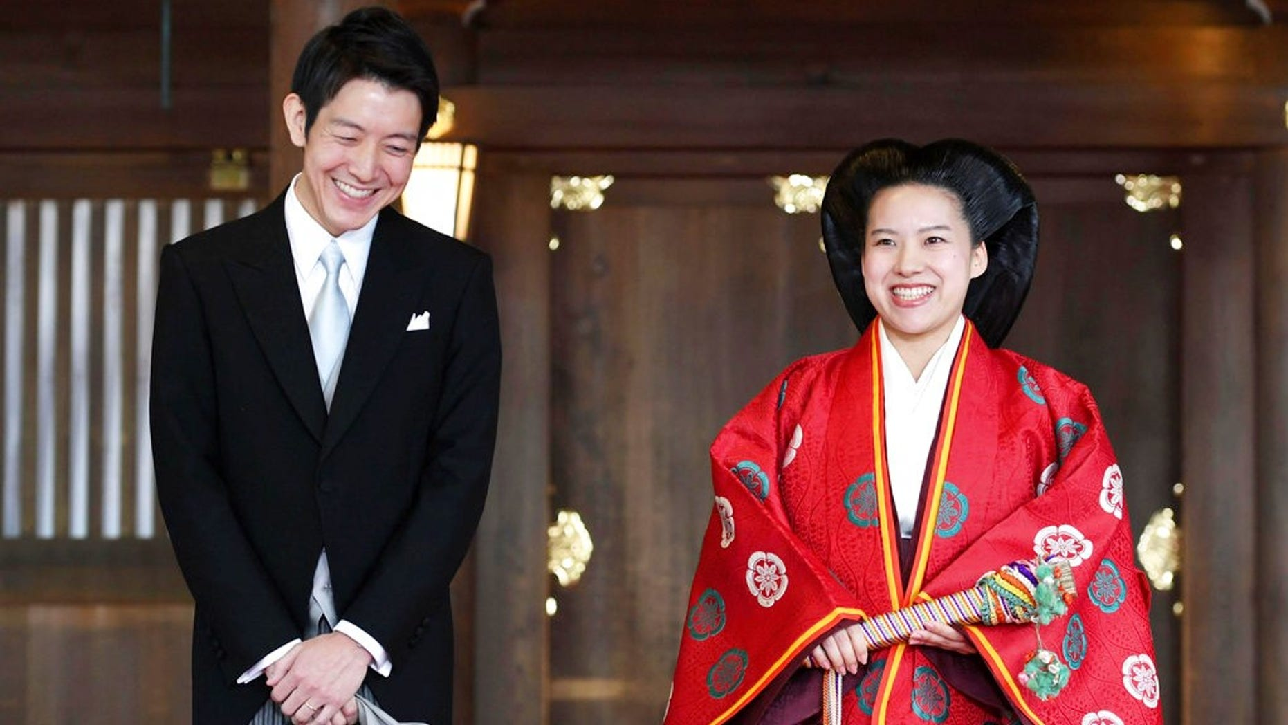 Japanese Princess Ayako, right, dressed in traditional ceremonial robe, and groom Kei Moriya, left, speak to the reporters after their wedding ceremony at Meiji Shrine in Tokyo, Monday, Oct. 29, 2018. Japan's Princess Ayako, the daughter of the emperor's cousin, has married Moriya, a commoner in a ritual-filled ceremony at Tokyo's Meiji Shrine.(Kyodo News via AP)
