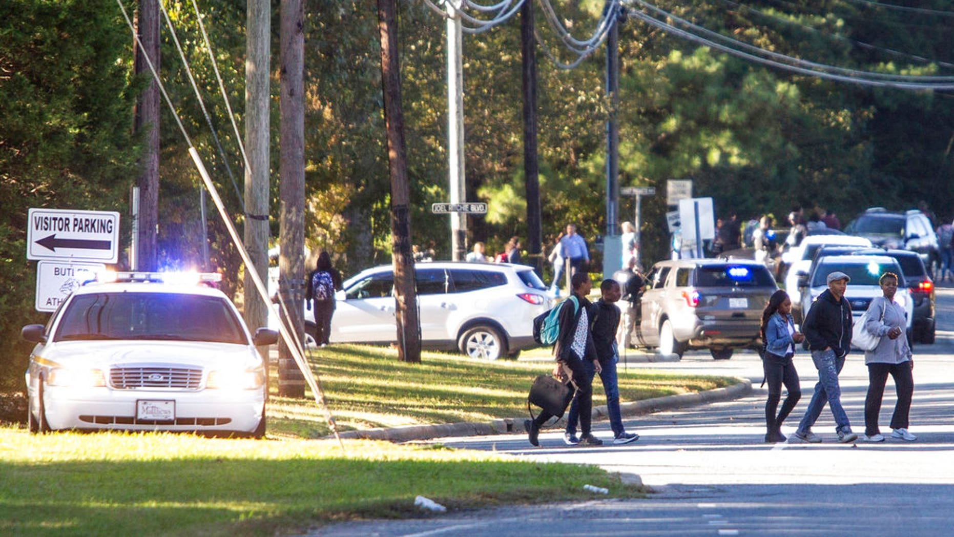 A student shot and killed a fellow classmate during a fight in a crowded school hallway Monday, officials said, prompting a lockdown and generating an atmosphere of chaos and fear as dozens of parents rushed to the school to make sure their children were safe.