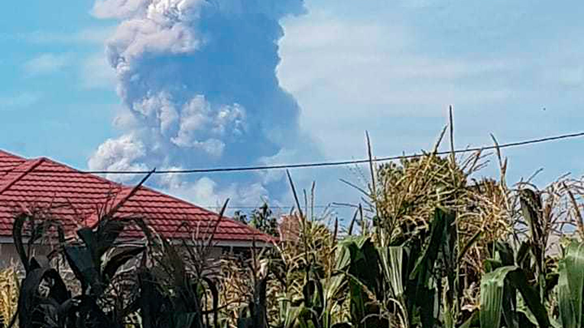 Volcano erupts on same Indonesian island as earlier quake.