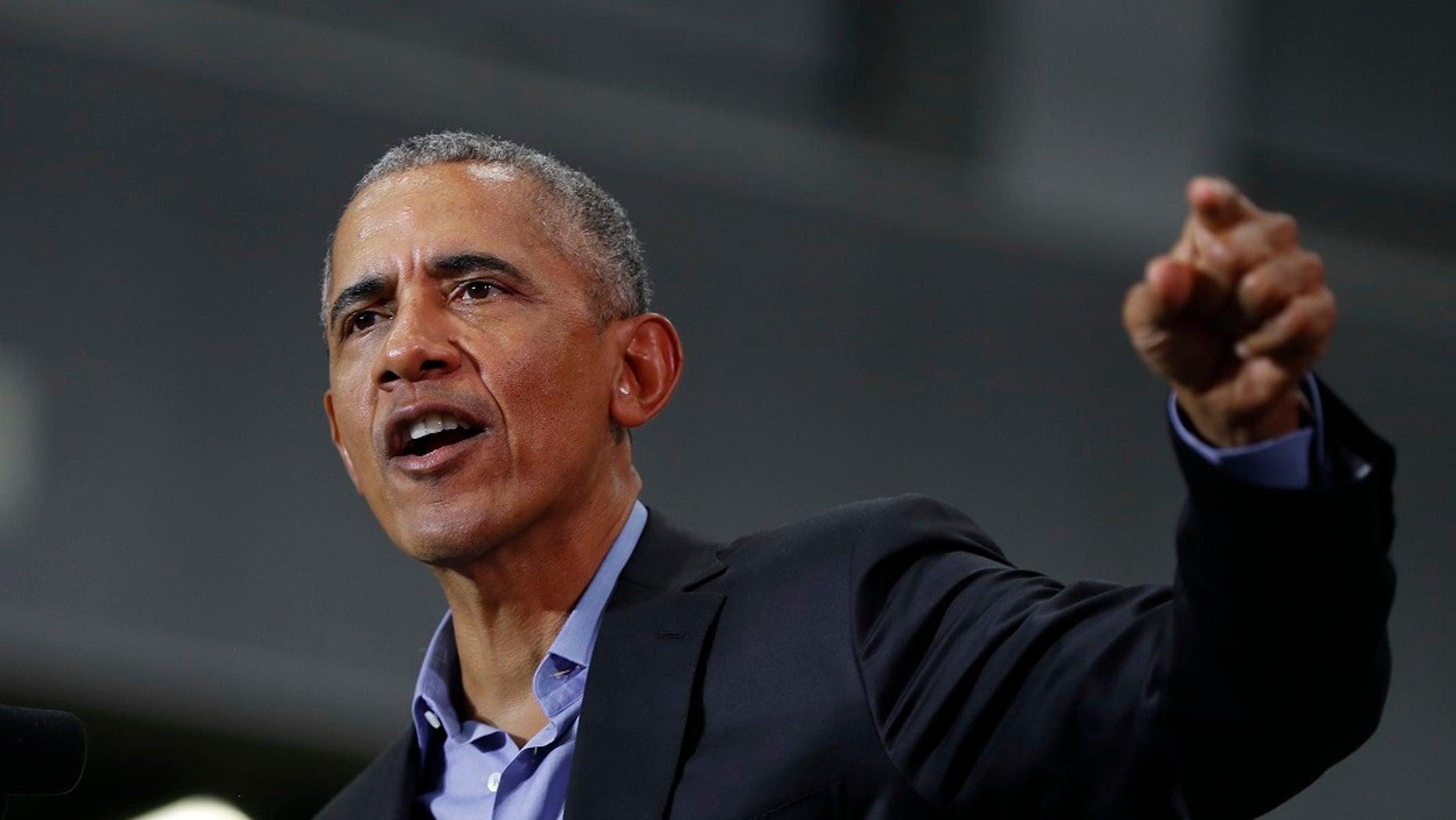 Former President Barack Obama speaks during a rally in Detroit on Friday.