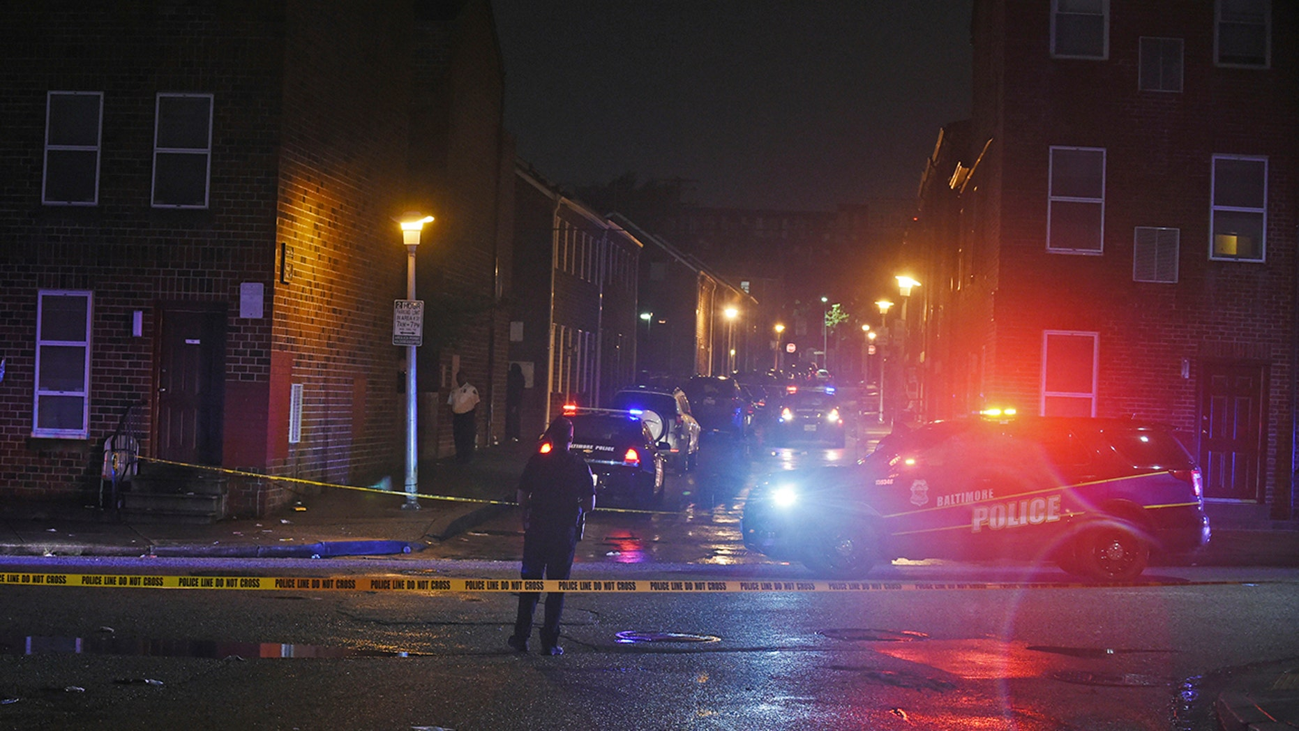 Baltimore City police officers block off the scene of a shooting in Baltimore on Sept. 23. The shootout between a man in a violence-prone Baltimore district and a police officer taking part in a crime suppression initiative left the officer wounded and the suspect dead.