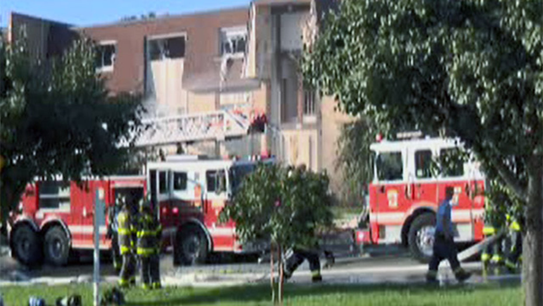 Firefighters respond to a gas explosion in Baltimore Wednesday.