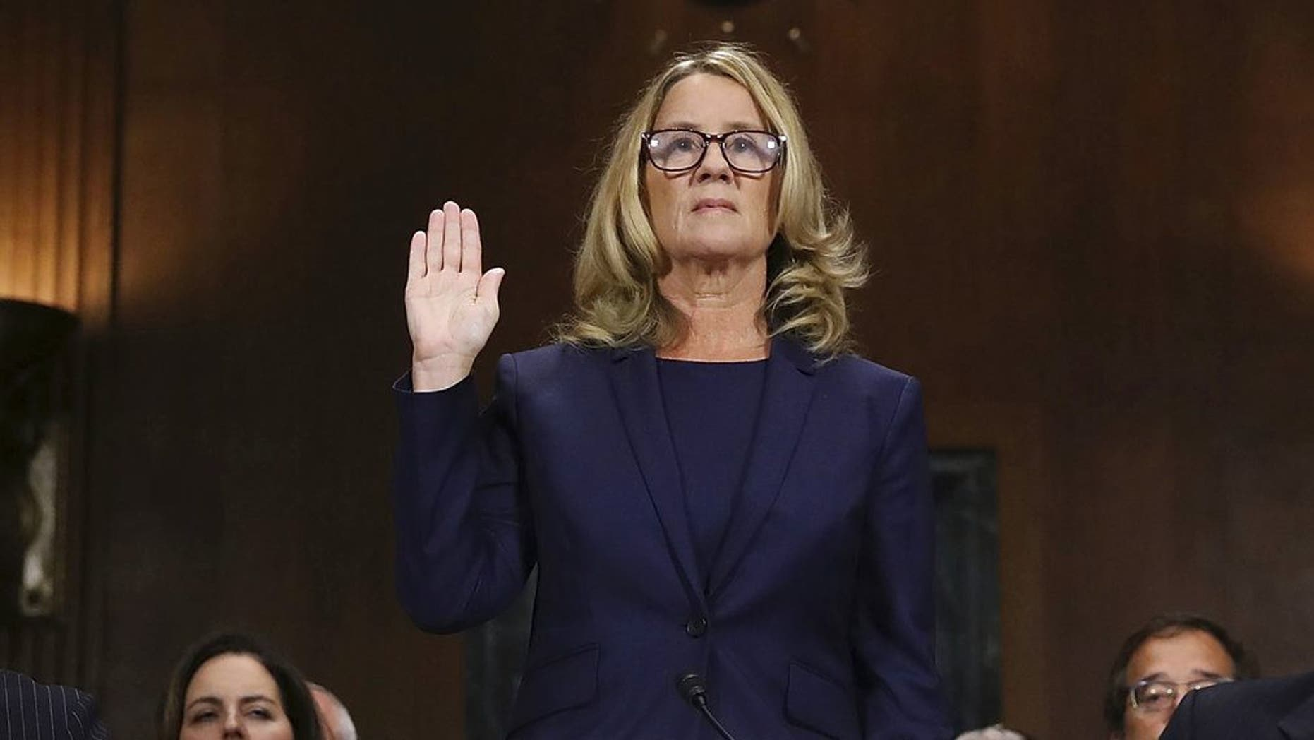 Christine Blasey Ford is sworn in before the Senate Judiciary Committee on Capitol Hill in Washington on Thursday, Sept. 27, 2018. (Win McNamee/Pool Photo via AP)