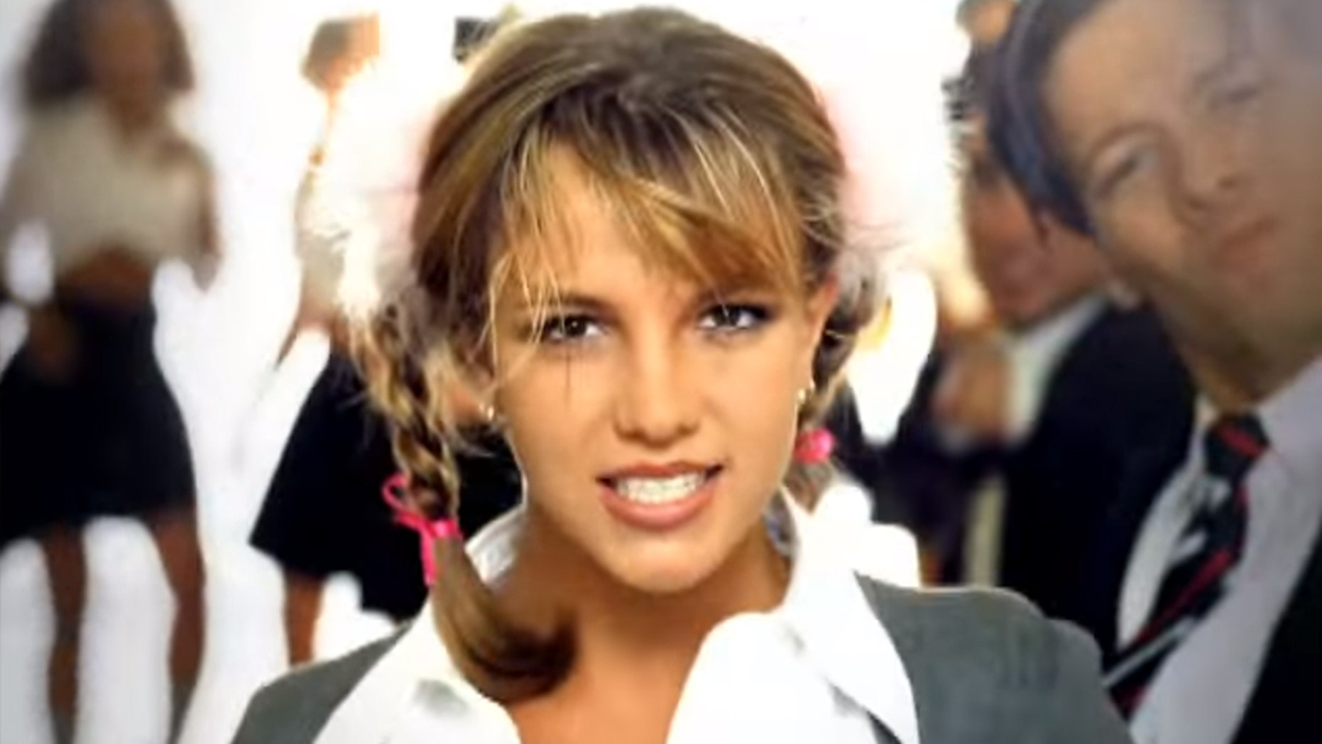"Britney Spears celebrated the 20th anniversary of her debut single ""...Baby One More Time"" on Tuesday. The singer is pictured here in the music video for her hit, which was released in 1998."
