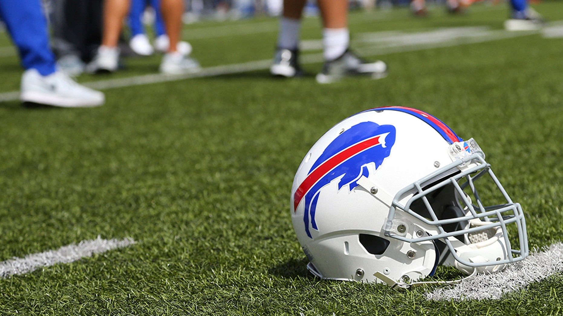 A Buffalo Bills helmet sits on the field before an NFL football game between the Buffalo Bills and the Los Angeles Chargers, Sunday, Sept. 16, 2018, in Orchard Park, New York.