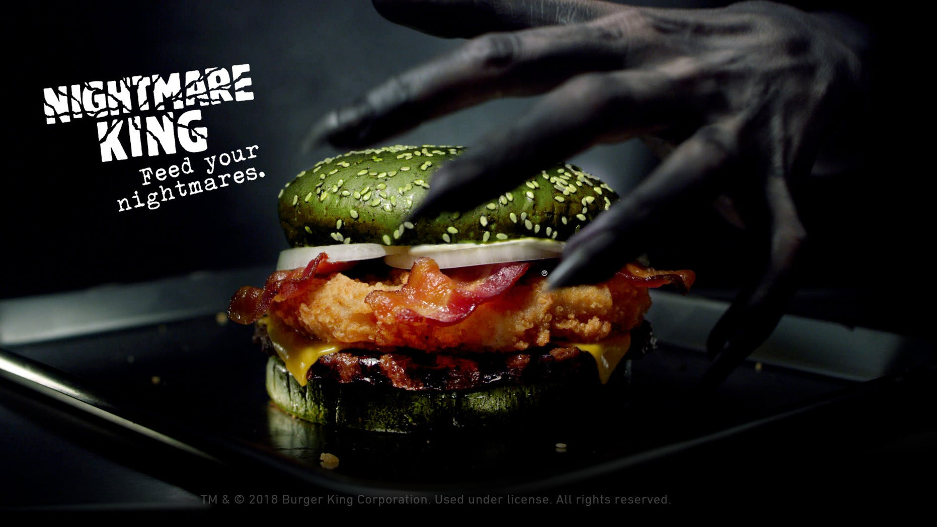 Burger King is releasing a green burger stuffed with chicken, beef and bacon just in time for Halloween.