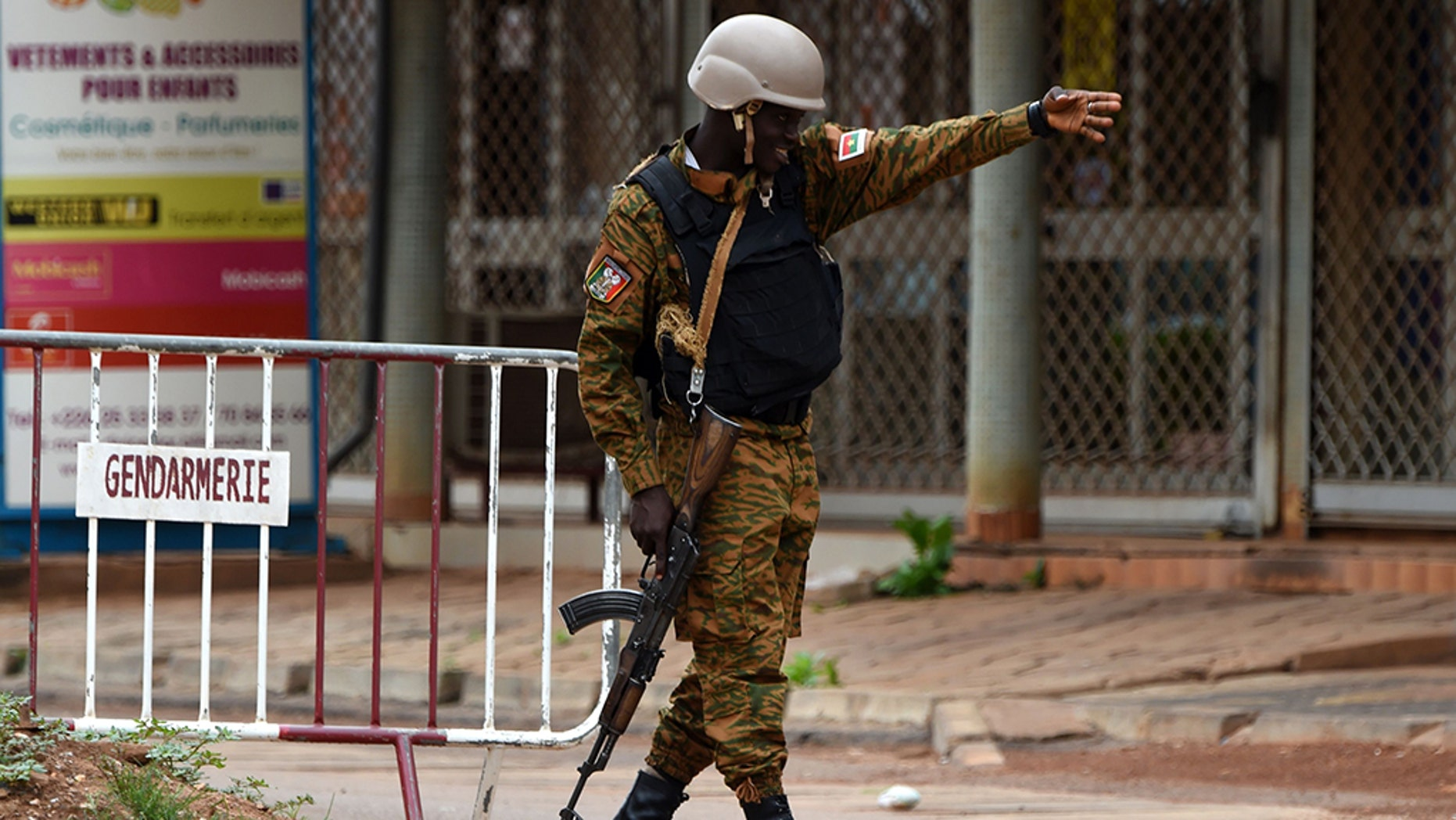 A security official gestures as he stands at a barrier close to the site of a terrorist attack in Ouagadougou on August 15, 2017. (KAMBOU/AFP/Getty Images)