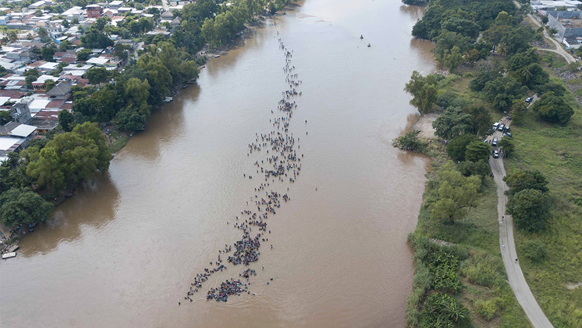 A new group of Central American migrants bound for the U.S border, wading across the Suchiate River, that connects Guatemala and Mexico, in Tecun Uman, Guatemala. (AP Photo/Santiago Billy)